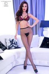Medium hole fishnet pantyhose, 1 classic and 1 with lurex. 2 pairs.
